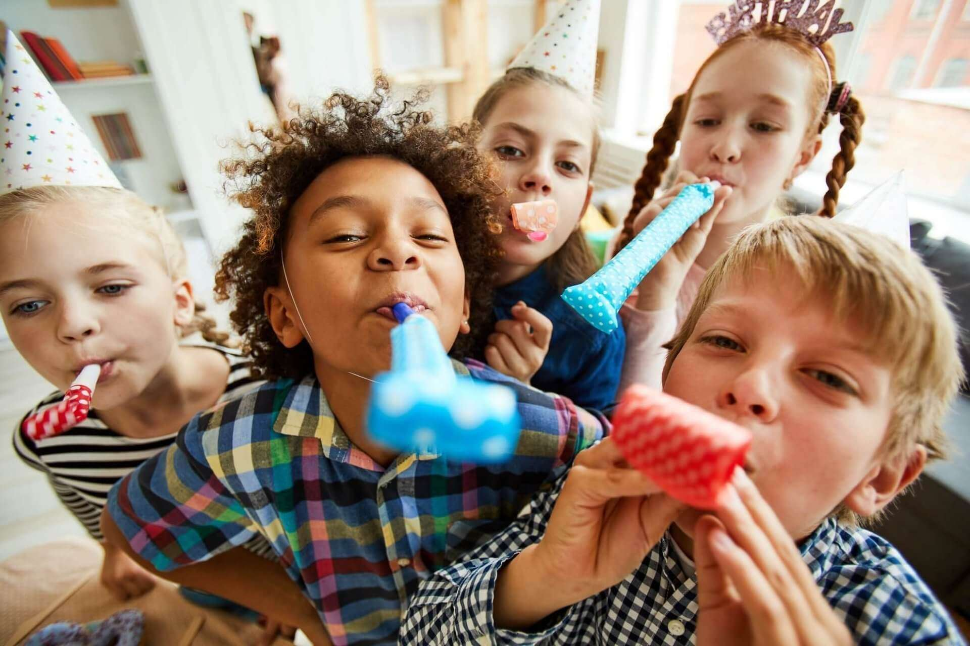 happy-kids-blowing-party-horns-4UDX265-e1589820925427.jpg
